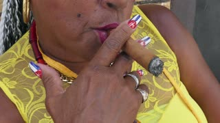 Cuban woman smoking cigar in Havana, Cuba. Hispanic black lady and tobacco smoke, Caribbean folklore