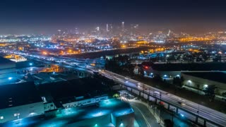 Los Angeles drone time lapse of urban freeway and city skyline with traffic at night
