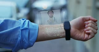 Man elegant suit responds, with the phone high technology with holography and augmented reality, to the doctor for treatment. Concept: immersive technology,futuristic medicine, congresses and meetings