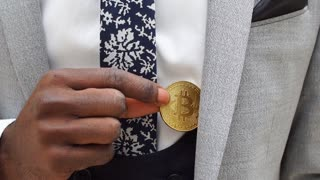 Man pick bitcoin from suit pocket . Man puts bitcoin in pocket of jacket. Cryptocurrency and online payment concept.