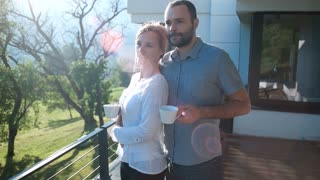 Middle age Couple Enjoy Drinking Coffee On Terrace In The Morning