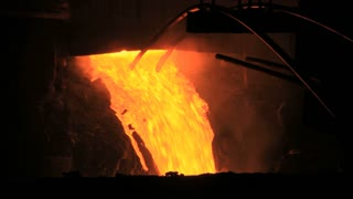 Molten metal pouring out of furnace. Liquid metal from blast furnace. Metallurgical industry process. Molten metal foundry. Pouring molten steel. Liquid steel pouring. Hot metal steel blast furnace