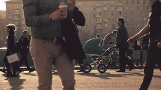 MOSCOW, RUSSIA - APRIL, 29, 2017. Parents with baby strollers walk in the park. Slow motion shot