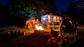 Motion Timelapse of Family Around Campfire