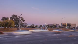 Motion time lapse at LAX airport in Los Angeles with street traffic