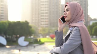 Muslim business woman talking on the phone