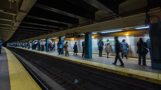 New York city subway time-lapse, showing the loading and unloading of passenger trains arriving and departing at stations