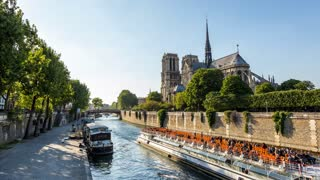 Notre Dame de Paris and Seine River Bateaux-Mouches in Paris, France Timelapse