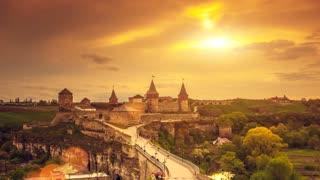 Old Fortress in Ancient City of Kamyanets-Podilsky castle in the evening, summer sunset. Exploring beauty world: Ukraine, Europe. Travel, holidays, recreation. Vintage yellow toning. Slow motion 4K