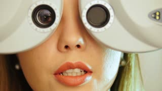 Ophthalmology clinic - woman checks vision eyesight, close up