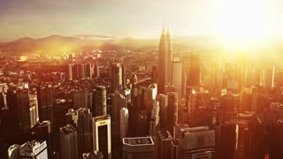 Orange sunrise. Aerial view of Kuala Lumpur city in Malaysia capital, tall buildings. Cinematic video of skyscrapers in big City