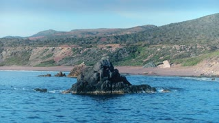 Panoramic view from above rocky cliff from sea water on empty coast line