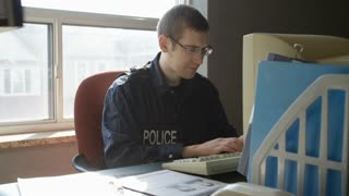 Police Officer Work Being Dropped On His Desk