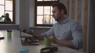 Portrait middle aged man using computer. Handsome casual manager typing on laptop keyboard focused on screen. Manager ponders his new project. Designer sitting alone in room chatting online with