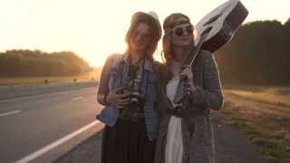 portrait of a hipster girls clothing hippie. young women smile and pose for the camera at dawn. slow motion