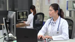 Portrait of an Asian female Doctor Working