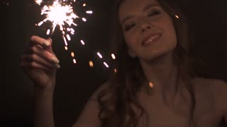 portrait of attractive girl with sparklers. sexy girl dancing
