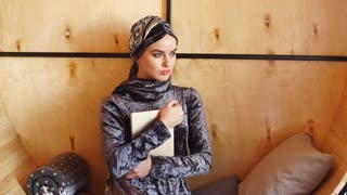 Portrait of Beautiful Arabic Muslim Girl Using Tablet.