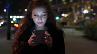 Portrait young woman using smart phone
