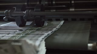 Printing Process - polygraph industry - brochures moving on the conveyor belt