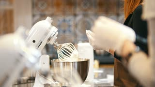 Process of cooking meringue whipped egg whites on mixer whisk
