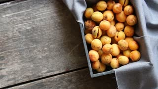 Ripe apricots in wooden box. Food background.