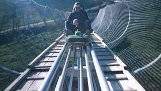 Roller Coaster In Forest. Father and son enjoying while riding forest roller coaster