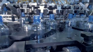 Rotating star wheels with small water bottles.
