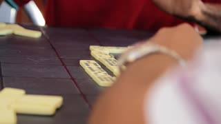Senior Hispanic Man Playing Domino With Old Friends in Cuba