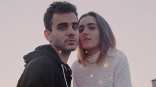 Slow motion portrait of beautiful couple of young teenagers or hipster millennials of new generation, romantic in love relationship boy and girl look in camera, serious and stylish fashion concious