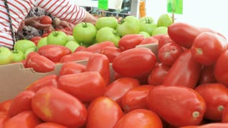 Slow motion. POV point of view - Fresh produce at the local Farmer's Market near historical Union Station.