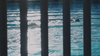 Slow motion shot of professional athletes training in swimming pool, swim the breaststroke style, morning workout for healthy lifestyle, gym membership sport activity. May 20018 in Barcelona, Spain