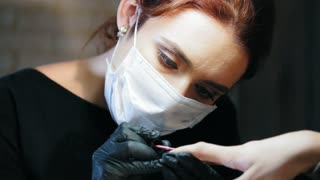 Small business - beauty shop - nail master in doing professional manicure - close up
