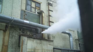 Steam pipe releasing hot air into the street