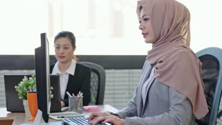 success Muslim business people using computer