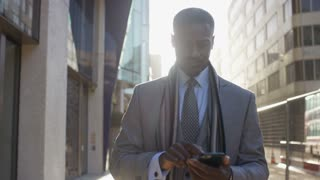 Successful business man walks using his phone, in slow motion