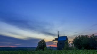 Sunrise and an Old Wooden Windmill. Time Lapse