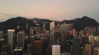 Sunset in financial center of Hong Kong. AERIAL view