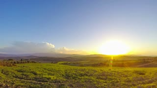 Sunset over the Tuscany Fields. Time Lapse