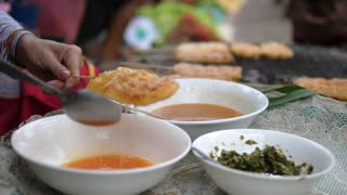 Tasty Fried Food on Street Kitchen in Asian Local Market. Luang Prabang, Laos, 23 August, 2017