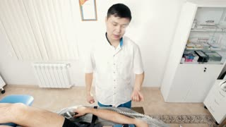 The doctor conducts the procedure, stretching the spine, chiropractic, alternative Asian Tibetan medicine