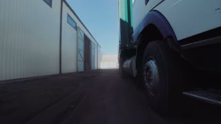 The wheels of huge truck parked at the warehouse. Horizontal outdoors shot