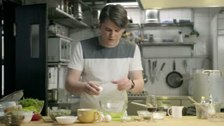 The young chef of the restaurant shows how to make scrambled eggs