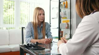 The young woman talking with doctor