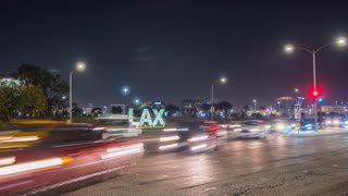 Time lapse at LAX airport in Los Angeles with street traffic