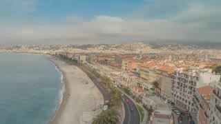 time lapse city view. Embankment, sea, beach and buildings in nice france. Azure coast on a sunny day. People walking on seafront cars driving on the road