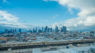 Time lapse in motion of downtown Los Angeles skyline with clouds and skyscrapers