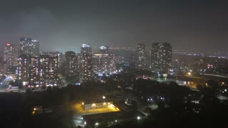 Time lapse of a downtown urban city scene in Mississauga, Ontario. Tilting up and shot at night.