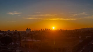 Time lapse of downtown city skyline as a stunning sunset transitions into night. Timelapse.