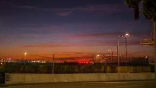 Time lapse of LAX airport with jet planes runway take off at night in 4K